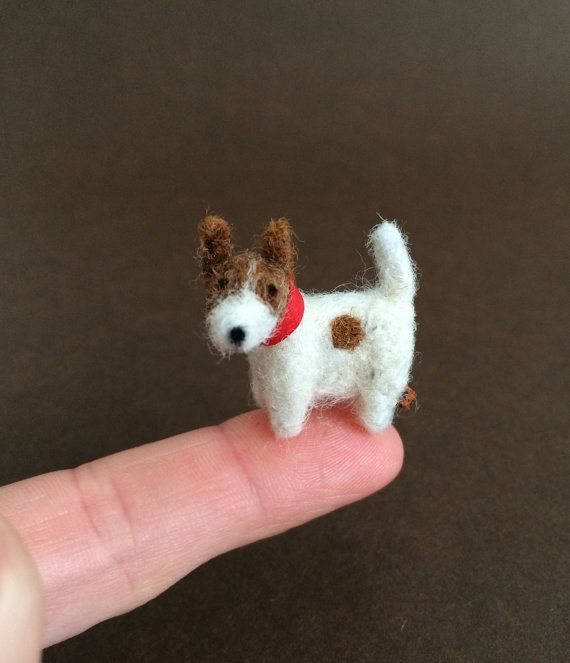 Miniature Jack Russell Terrier ~ Needle Felted Christmas Gift Miniature one of a kind Jack Russell Terrier. Made from a blend of British wool. Very small. Stands just 3cm floor to top of ears. Just over 1 inch. Red leather collar. Her back leg has a stitched on leather tag. Please note this is not a toy and is not suitable for children. www.trimbleberrybears.com www.facebook.com/trimbleberry.bears