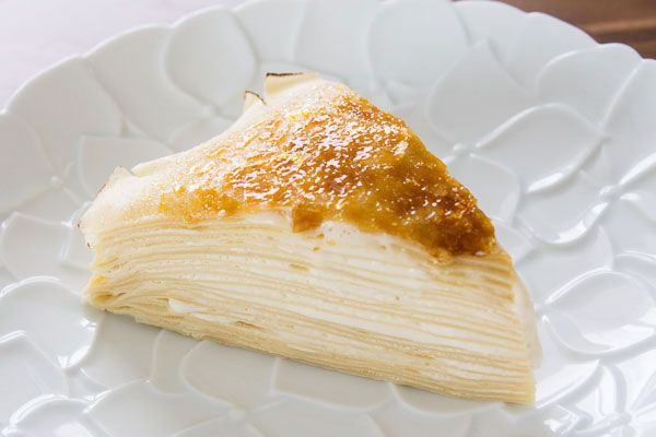 """Gâteau Mille Crêpes (""""thousand crêpe cake"""") by Marc Matsumoto, pbs.org: Made entirely on the stove, the crêpes are layered with maple-scotch pasty cream to form a layer cake, and the top of the cake is covered in a thin layer of crisp caramelized sugar. It's dense, creamy, moist and flavorful, with a delightful array of textures in each bite. #Cake #Mille_Crepes"""