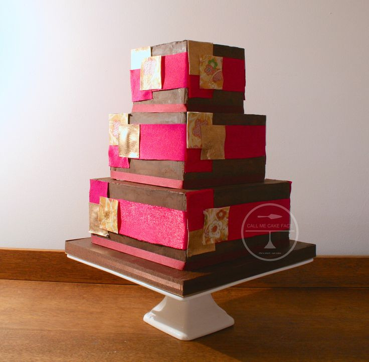 Valrhona Chocolate wedding cake with bands of hot pink silk.  Detailed in sugar printed patchwork pieces copied from the Brides Kimono Weddign dress.