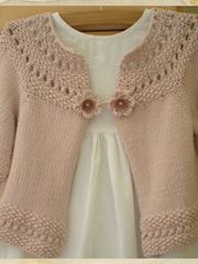 I am so knitting this cute cardigan