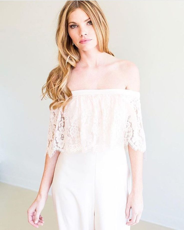 An elegant twist on the traditional bridesmaids dress: An elegant off the should lace romper. // Romper from THEIACouture // Photo by Jana K Tyler via Coastal Knot Bridal // www.southernbrideandgroom.com // @sthrnbrideandgroom