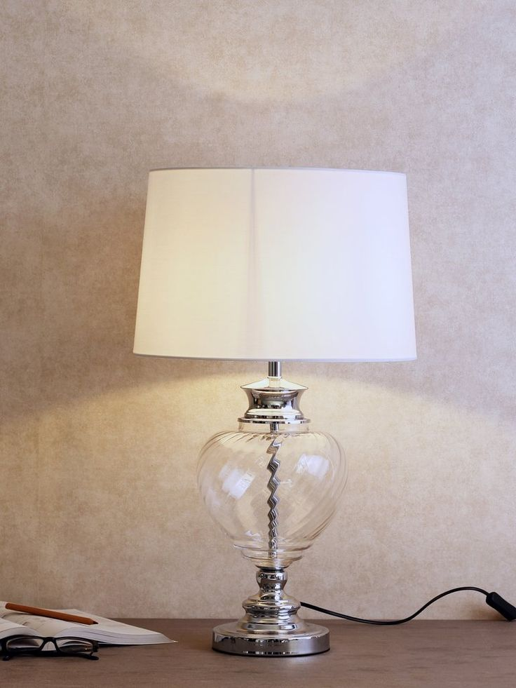 Ellen the ellen is a crystal table lamp shines with style it features a