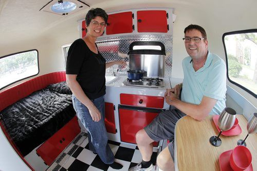 July 8, 2014 - 140708  -  On Monday, July 8, 2014 Kelly Klick and her husband Tom McMahon are photographed in their restored 1975 Boler camper. The 1975 Boler camper is owned by  Kelly Klick and Tom McMahon and was restored by Kelly and her father Jack. John Woods / Winnipeg Free Press