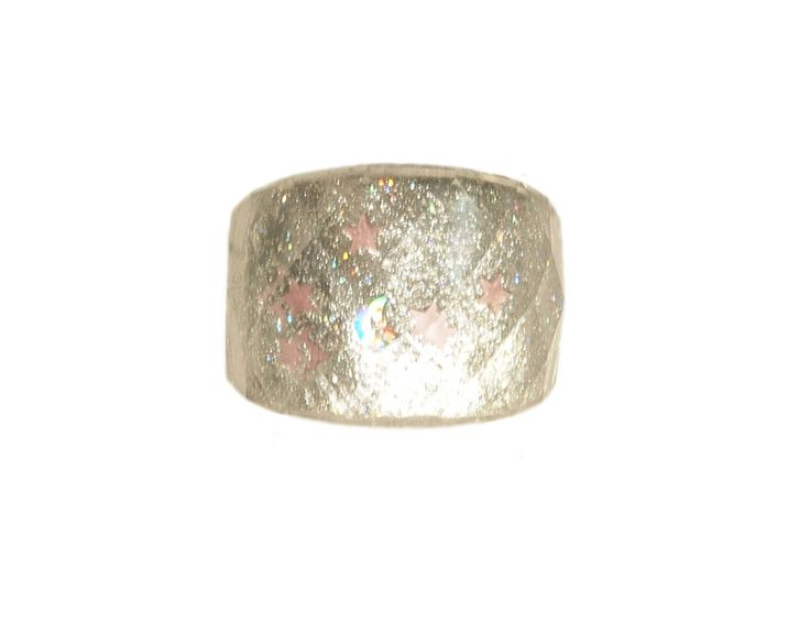 This stunning multi-cut crystal shines bright like a diamond. The multiple hues make it so easy to pair with your wardrobe as long as you keep accessorizing to a minimum letting the cocktail ring speaks for itself!