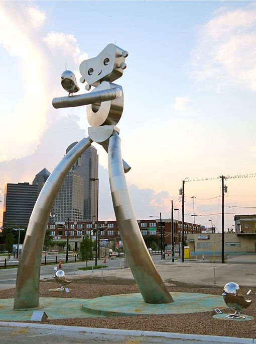 The Traveling Man Walking Tall - a 38' sculpture across from the Deep Ellum Rail Station in Dallas, Texas