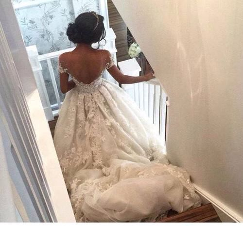 Off the shoulder backless wedding gown with tiara.                                                                                                                                                                                 Mais