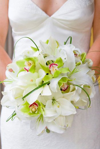 """Elegant bridal bouquet featuring cymbidium orchids, casablanca lilies and bear grass loops. Created by Bouquets of Austin."""