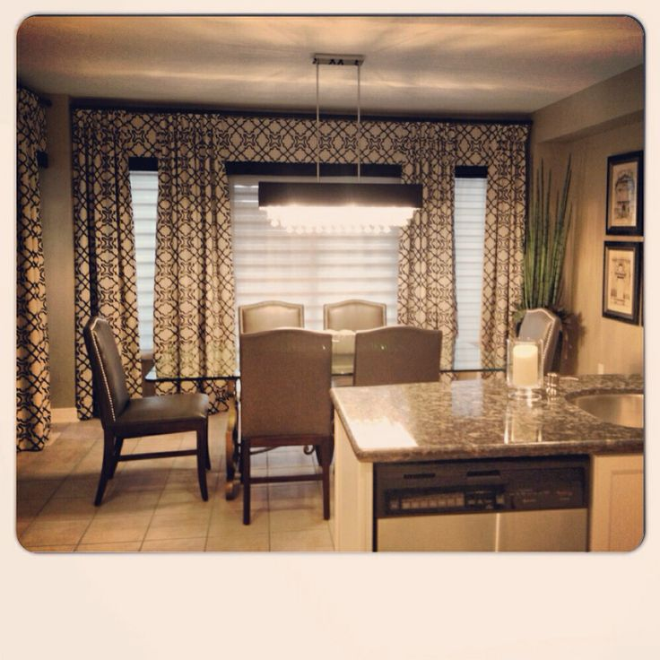 Panels in a linen fabric with this bold black velvet print makes a statement in this kitchen!!