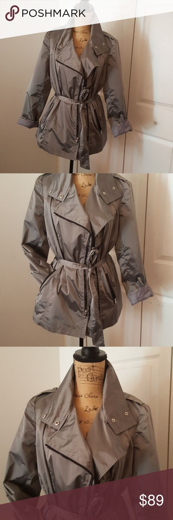 JONES OF JONE YORK RAIN JACKET This is brand new. Awesome metal LOOKING gunmetal jacket. Has two sets of zippers up front so it can be bigger or smaller. A lot of pockets. Lined. Jones New York Jackets & Coats Utility Jackets
