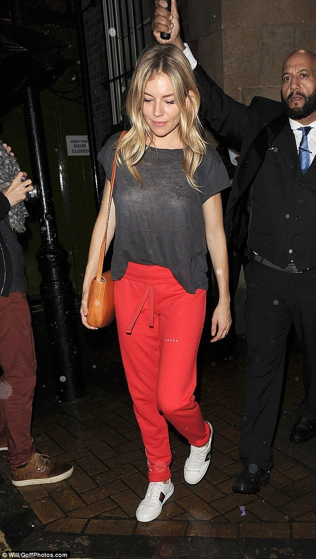 Casual chic: Sienna Miller dressed down in red tracksuit bottoms as she left the Apollo Theatre in London on Wednesday night following another performance in Cat On The Tin Roof