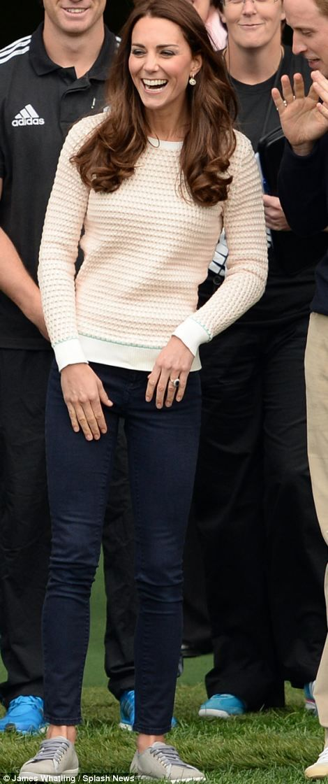 A more casual tone for a bit of rugby including her faithful J Brand skinny jeans, £135, Jonathan Saunders sweater, £370, and Mint Velvet plimsolls, £89. Total: £594