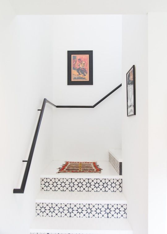 tiled stairs in white room