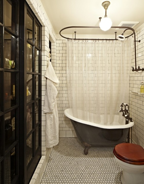 Masculine take on a vintage bathroom. Small hexagon floor tiles, subway wall tiles with grey grout
