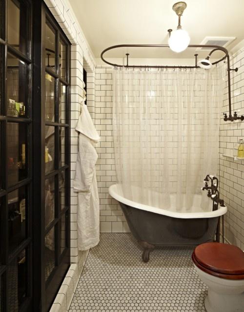 Small hexagon tile, subway tile, dark grout, sliding bath storage, vintage
