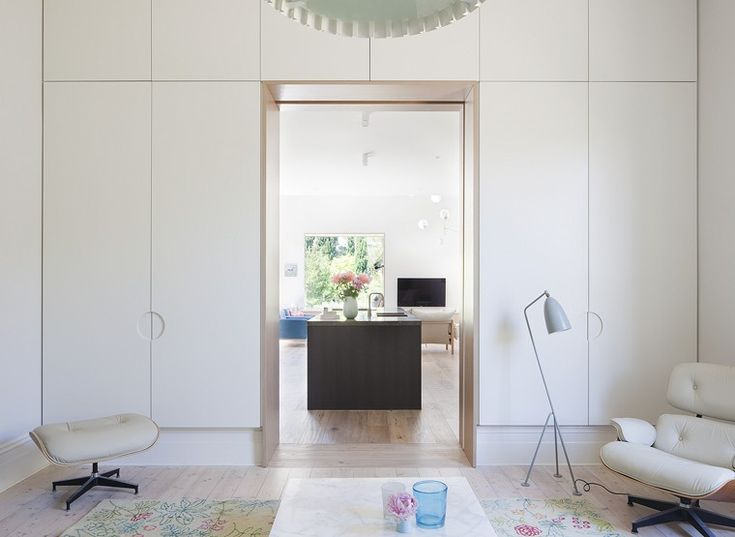 Cabinetry and cut-out handles + timber framed doorway / St Kilda East House by Clare Cousins Architects