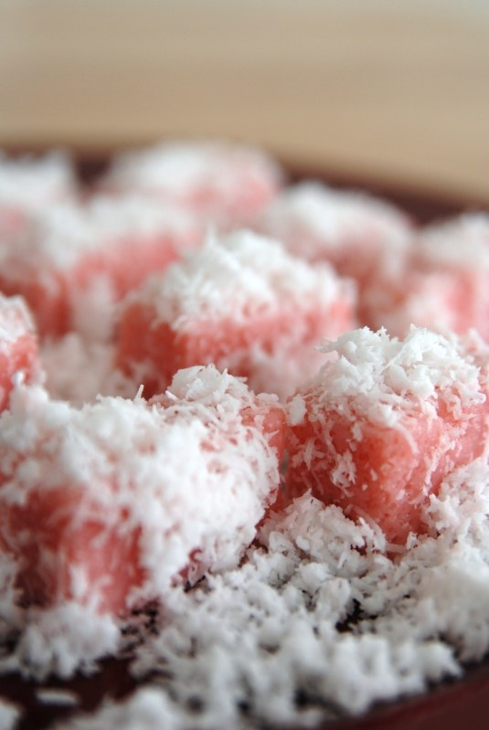 Kueh Ongol Ubi. a chewy nonya snack rolled in fresh coconut shavings (singapore/malaysia, southeast asia)