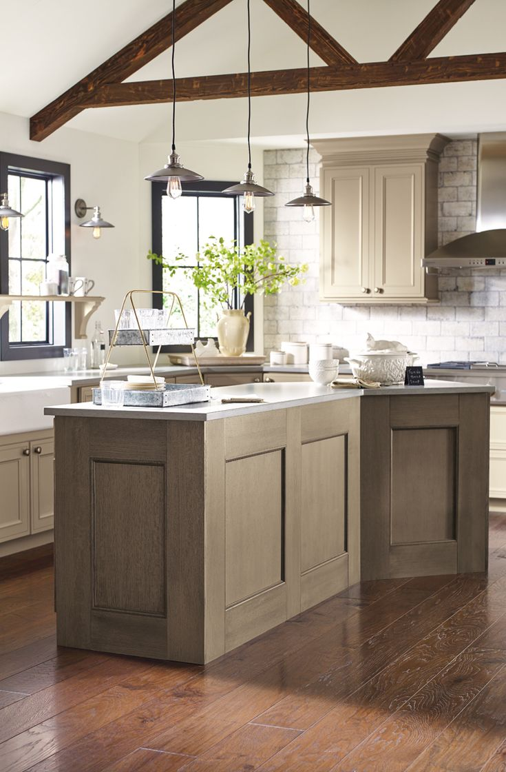 light wood finishes create the perfect backdrop for this casual kitchen inspired by nature on kitchen remodel light wood cabinets id=63055