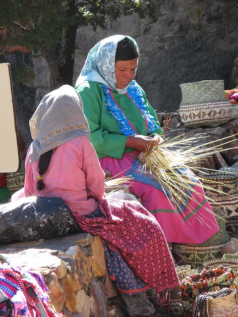 Tarahumara Mother and Daughter weaving and selling pine needle