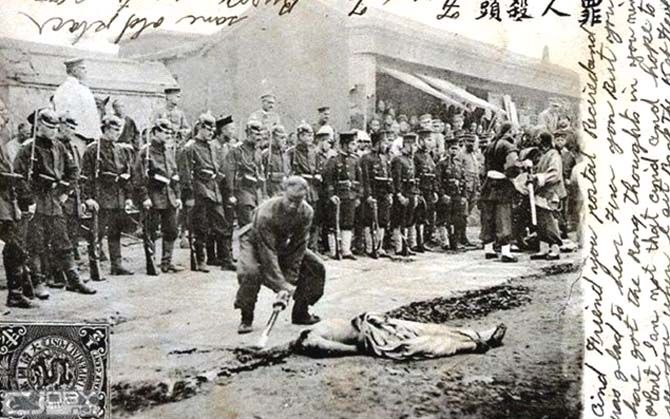 "Germans & Japanese relief troops witness the execution of a Boxer, China Relief Expedition ""Boxer Rebellion"" 1898-1900."