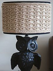 """Free pattern - Lampshade Cover - """"Light Up the Room,"""" episode 306 of Knit and Crochet Now!, shows you how to make a plain lampshade one-of-a-kind using crochet and knit. The Shell Stitch Lampshade Cover, designed by Carrie Carpenter, is the featured crochet project from this episode. It can be made using yarn from the Tahki Yarns Cotton Classic collection, a size G crochet hook and a tapestry needle."""