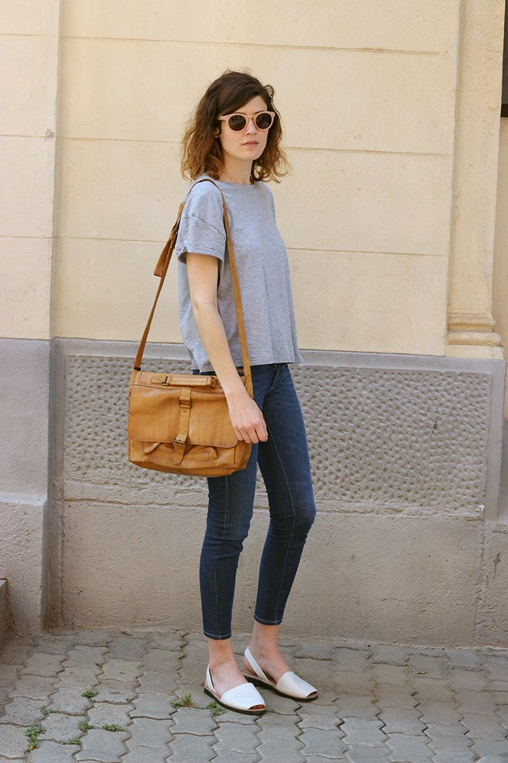 street style barcelona - Menorcan style sandals, cute tee, slim jeans, tan bag