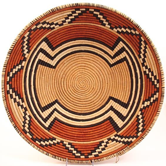 Africa | Bukedo & Raffia Bowl  basket from Uganda | Bukedo (local term for banana leaf stalks) creates a sturdy base that dyed raffia is coiled around to make this strong basket. These baskets are traditionally used food in Uganda.
