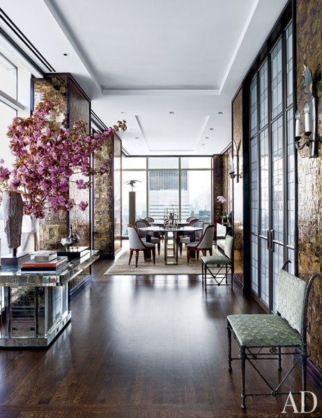Structural columns along the apartment's perimeter were sheathed in Indian mica, as were a number of the walls, adding to the home's glamour and warmth   archdigest.com