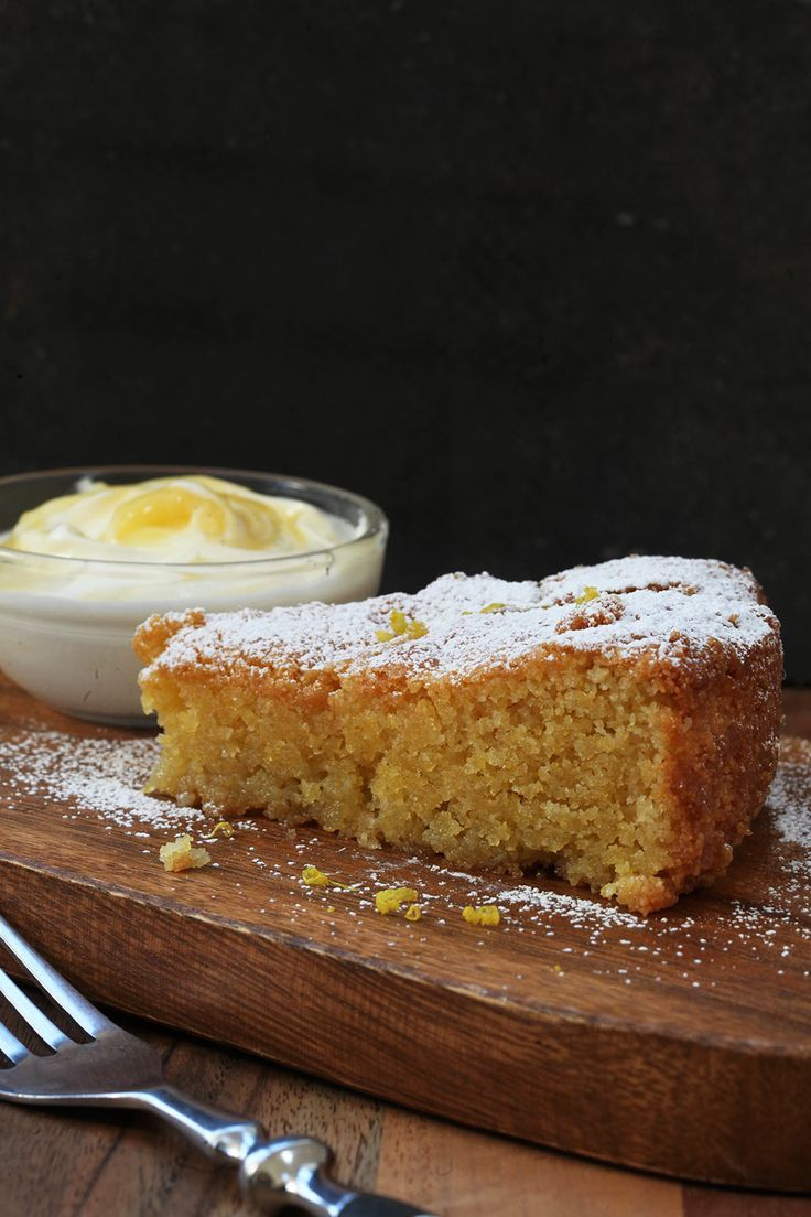 Nigella's Lemon Polenta Cake with lemon curd cream is an easy to make gluten free dessert. Perfect served warm as a dessert or cold as a cake.