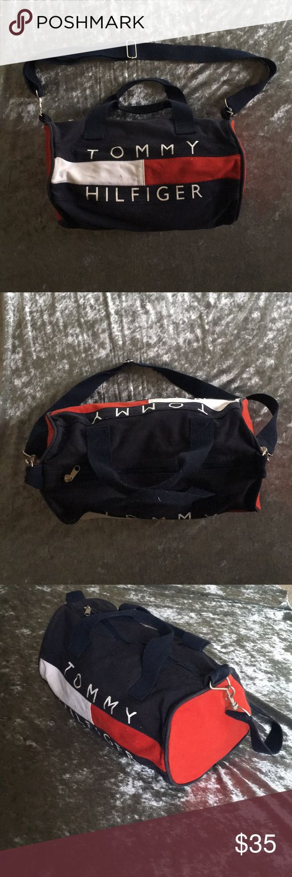 "Tommy Hilfiger duffel bag Small duffle bag. It has been used and washed. Mint condition but some signs of wear show.   Measurements: Length 14"" Height 9""  Width 8"" Tommy Hilfiger Bags Travel Bags"
