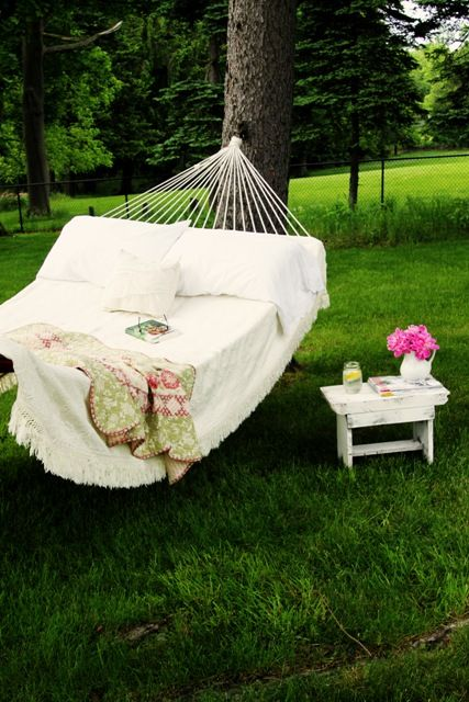 I want a hammock again!  This makes me dream of lovely summer nights with the girls looking up at the stars and watching the fireflies after a dusk in the garden.  Soon...