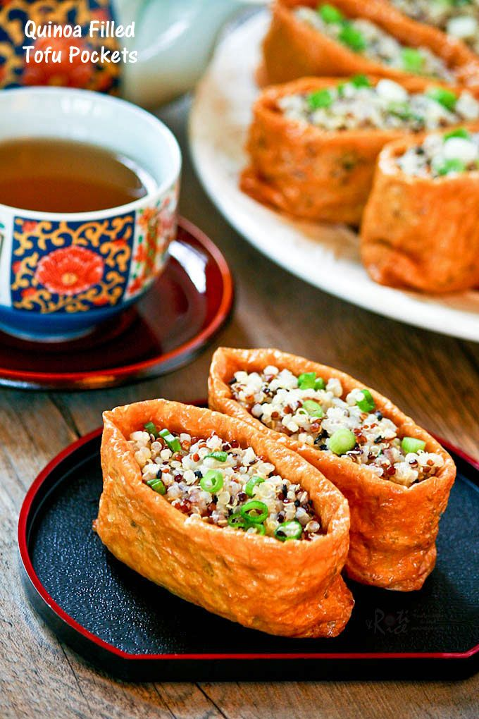 Delicious vinegar flavored Quinoa Filled Tofu Pockets resembling inari zushi. The tofu pockets are deep fried and seasoned with sweetened soy sauce.   RotiNRice.com