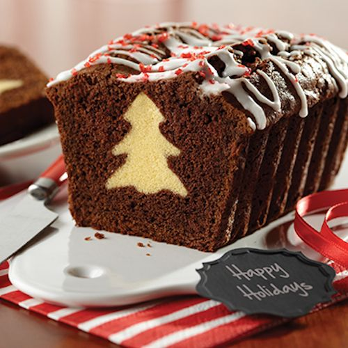 Chocolate Surprise Loaf Cut out frozen pound cake slices with cookie cutters and line them up in a pan touching each other. Surround with chocolate batter and bake.