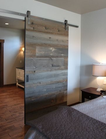 I'm so in love with this sliding door made with reclaimed barn wood. Old wood meets modern design.