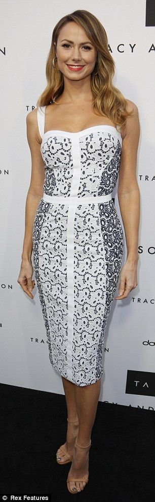 Flawless: Stacy Keibler looked incredible in a figure-hugging black-and-white patterned dress