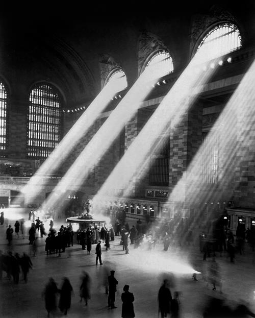 Grand Central. Where commuters come together. Beautiful sunlight casting through the windows of the Grand Central Terminal (1935).