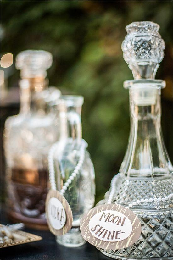 label vintage bottles #roaring20wedding #cocktailstation #weddingchicks http://www.weddingchicks.com/2014/01/02/easy-roaring-20s-wedding-ideas/