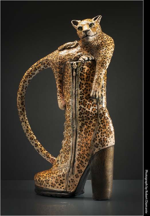 Fit to a Tea is a teapot in the form of a leopard-patterned boot surmounted by an emerging leopard.