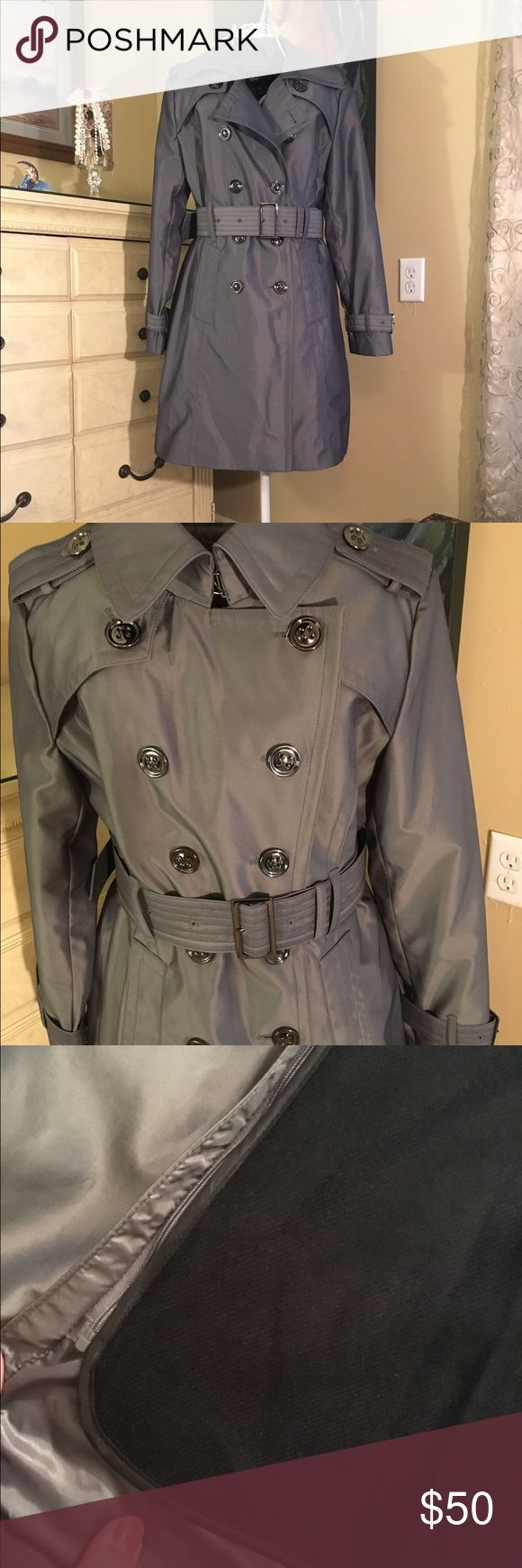 NWOT London Fog Double Breasted Trench raincoat Brand new , never worn, lined plus additional warm 100% acrylic lining which could be easily unzipped during warmer weather. Gray-metallic color. Size PM. London Fog Jackets & Coats Trench Coats