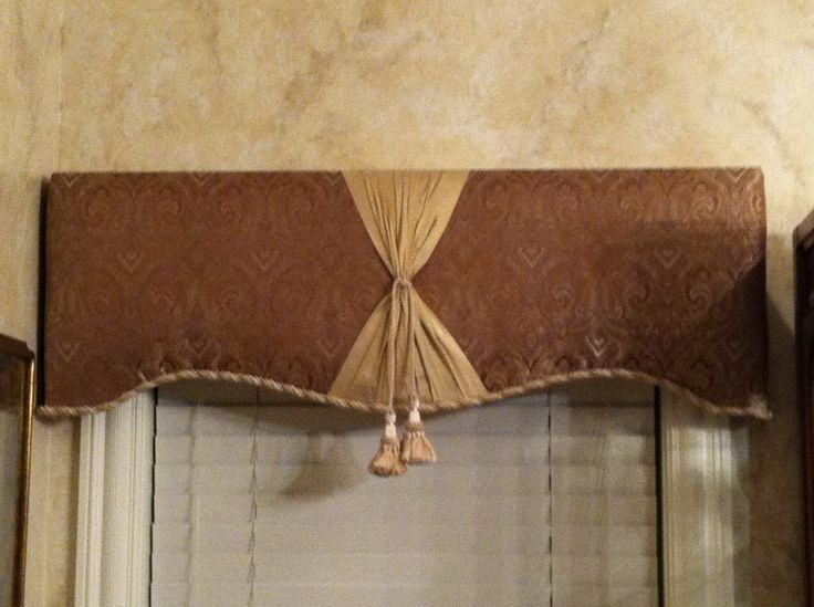 Secure cornice board centered on window frame using brackets supplied with wooden cornice board.