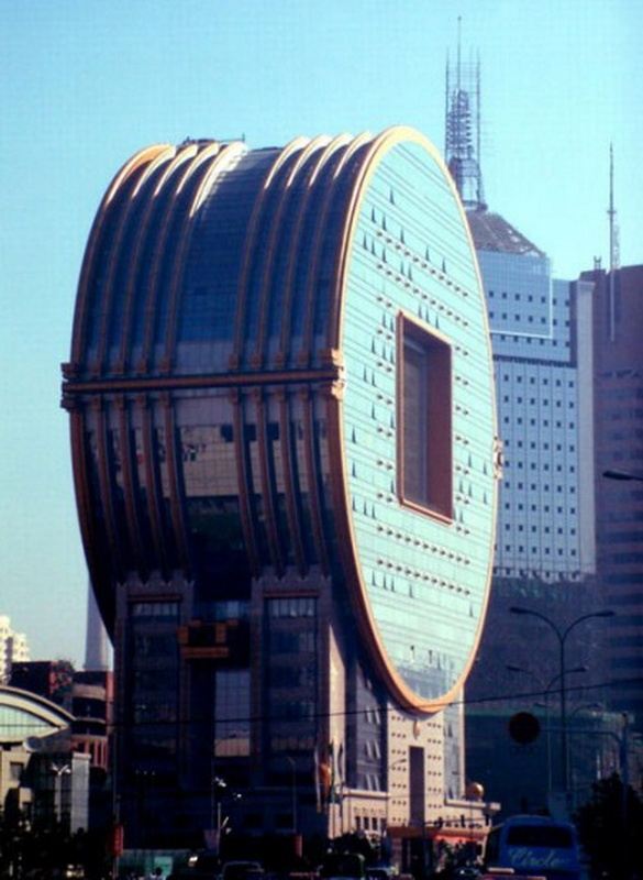 Fang Yuan Building in Shenyang, China. Designed by architect C. Y. Lee, who decided to combine the shape of ancient Chinese coins with a square neckline and a modern office building. Opened in 2001 Picture: Quirky China News / Rex Features