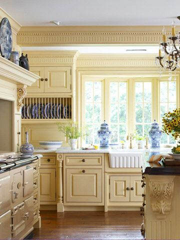 Cottage kitchen with yellow cabinets and blue and white accents.  Love the butter yellow.  Would switch the blue out for a teal green
