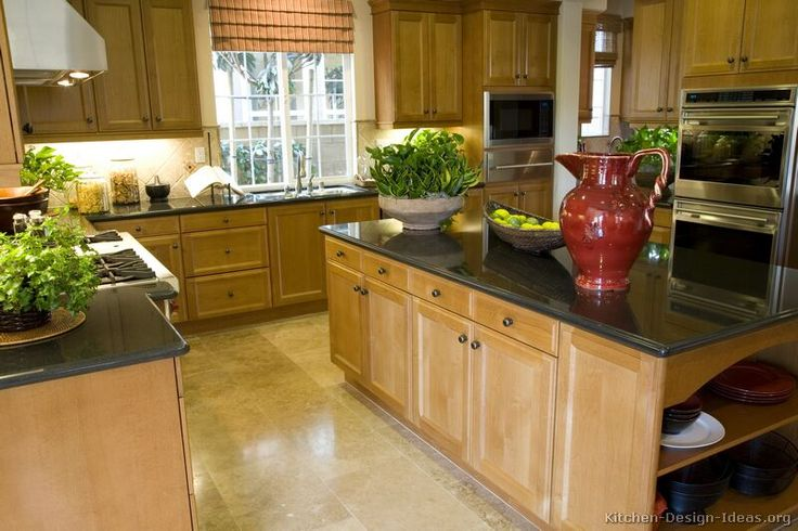 My cabinets are this color, and we are trying to decide what do replace the countertops with. Traditional Light Wood Kitchen Cabinets #68 (Kitchen-Design-Ideas.org)