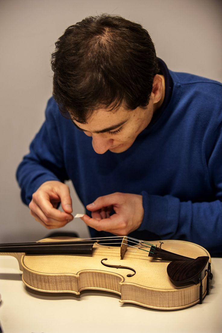 Dr. Alessandro Liberatore is preparing a violin for analysis