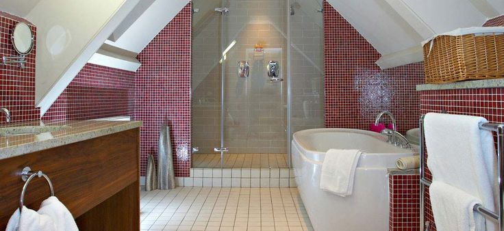 The apartment bathroom, with under floor heating, has a bath and walk-in double shower, and a selection of Arran Aromatics toiletries.