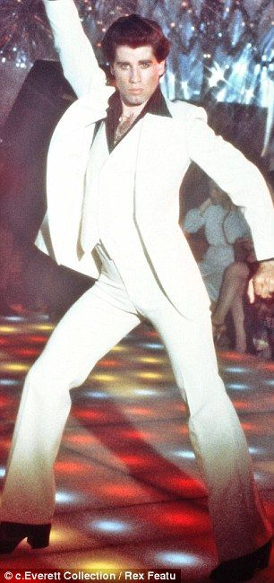 John Trovolta in the film Saturday Night Fever introducing the trend of the classic white suit.