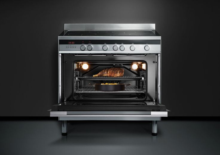 Fisher & Paykel 90cm Freestanding Induction Cooker (OR90SDBSIX1). This 90cm Freestanding Cooker gives you the flexibilty to prepare several courses simultaneously with an extra large oven, combined with a 4-zone induction cooktop. The unique design and clean lines in black reflective glass and stainless steel complement the style and elegance of any modern kitchen.