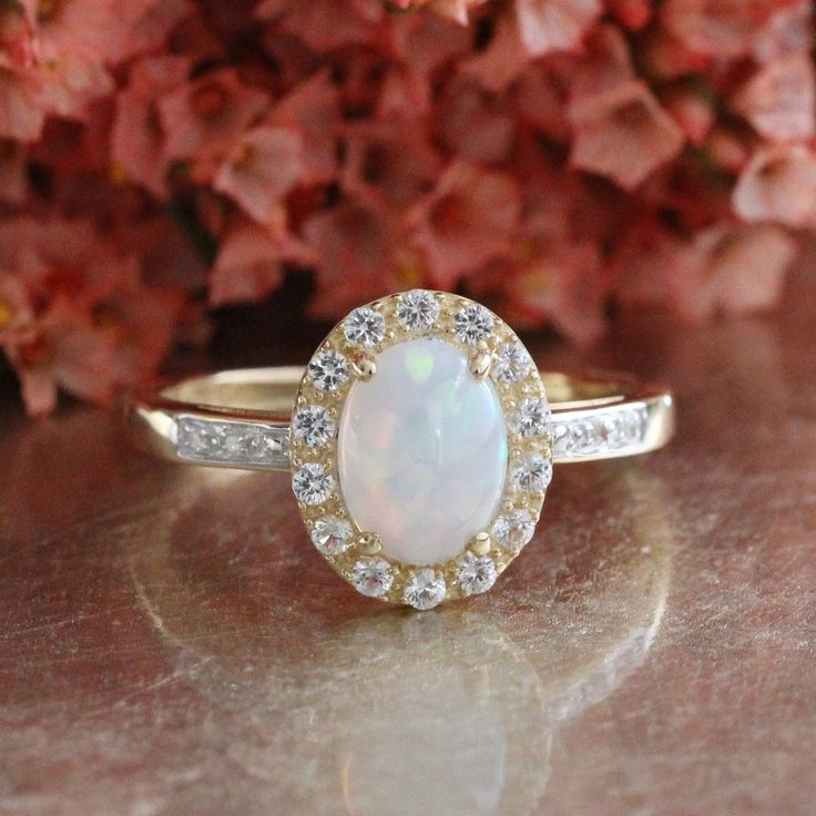 Opal Engagement Ring in 14k Yellow Gold Halo White Sapphire Ring Oval Cut Gemstone Ring October Birthstone Ring, Size 7.25 (Resizable) by LuxCrown on Etsy https://www.etsy.com/listing/286478739/opal-engagement-ring-in-14k-yellow-gold