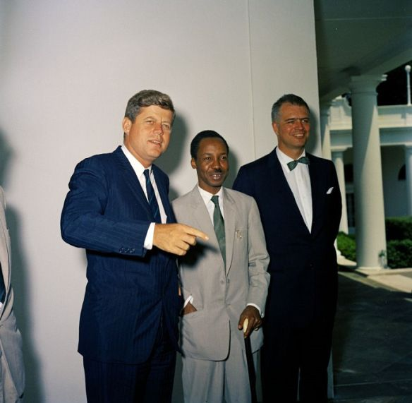 1961. 18 July, President John F Kennedy is seen with Prime Minister Julius Nyerere of Tanganyika at the West Wing Colonnade, White House, Washington, DC