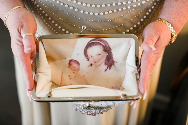 A gift clutch bag to mother of the bride and mother of the groom personalized with a childhood treasured photo.  This would make a beautiful present to a new mom too!   Photo by Creative Focus Photography. Clutch bag handmade by ANGEE W.