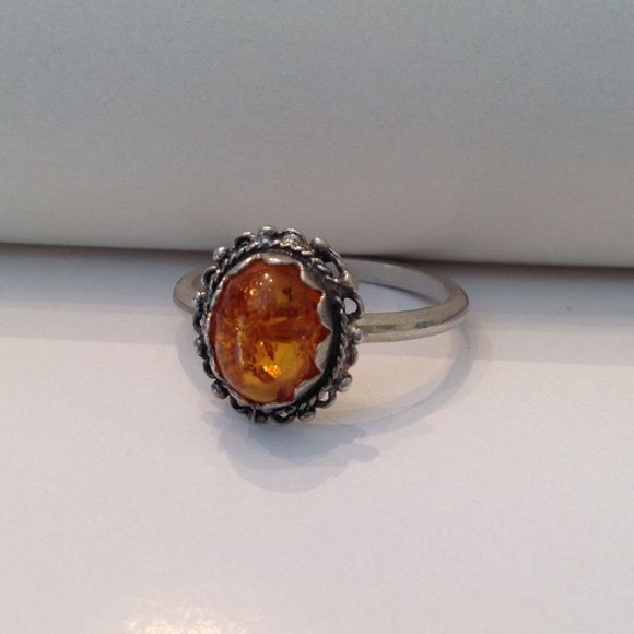 Vintage Sterling Baltic Amber ring Vintage Sterling Baltic Amber ring. Size 8 Sterling with 925 stamp on outside of band. Stamp is showing some wear, very little tarnish. Vintage Jewelry Rings